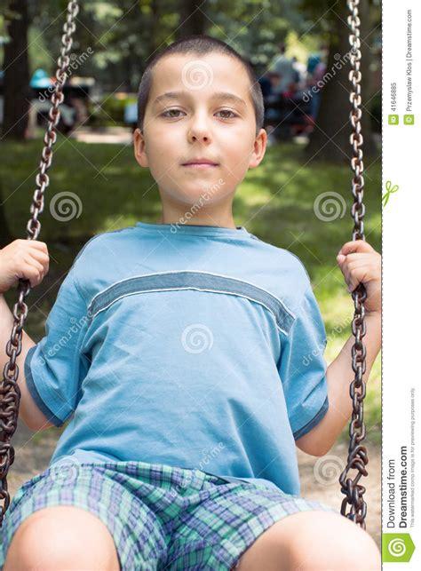 boy swing boy on a swing stock photo image 41646885