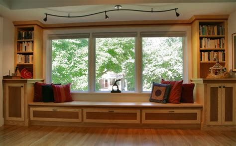 custom cabinets window seat and s curved track light