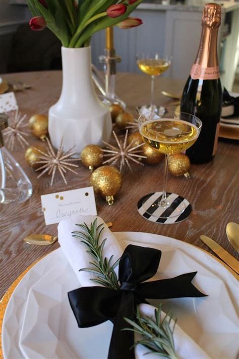 chic holiday tablescape in gold black and white decoist