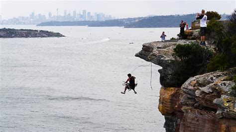 rock swing thrillseekers who freefall off the cliffs at north head