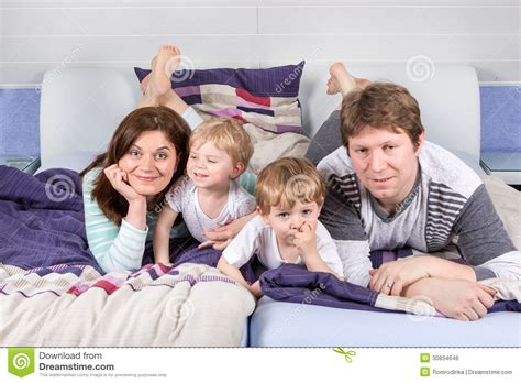 fun home a family happy family of a four having fun at home royalty free stock image image 30834646