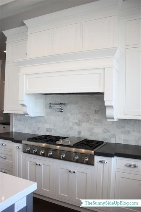 dark kitchen cabinets with white and carrera marble i carrera marble subway tiles transitional kitchen