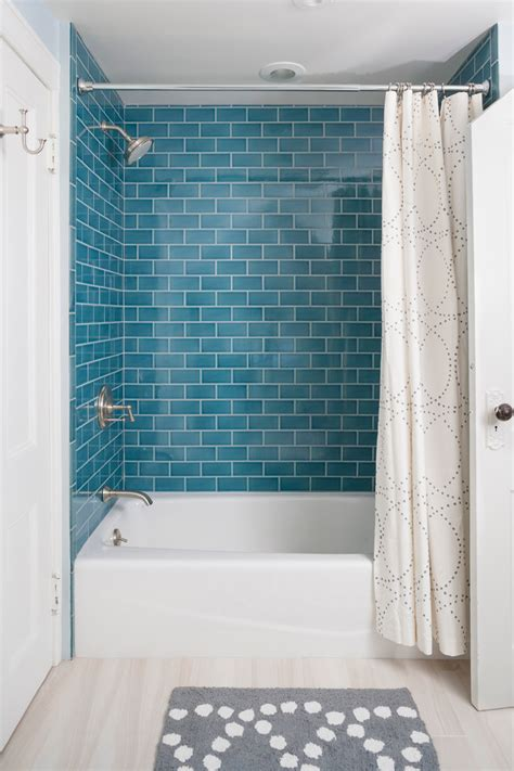 blue subway tile bathroom with attic beige