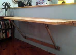 wall mounted desk with angled supports folding butcher block table from origami fuggs and foach