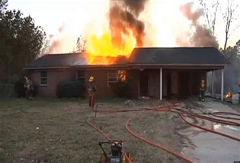 black woman house on fire woman burns down home setting snake on fire huffpost