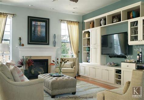 blue gray family room  white wood wall unit tan