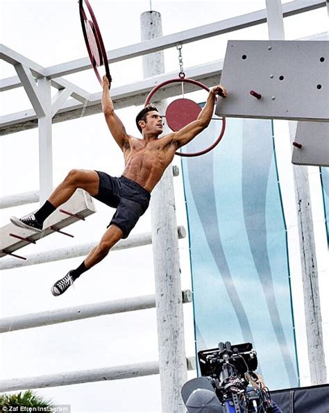 zac efron training zac efron flaunts his jacked muscley arms on men s fitness