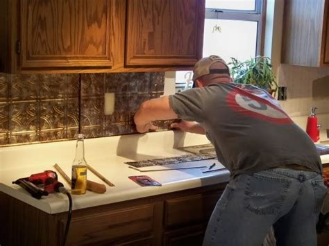 how to apply backsplash 19 best images about tin backsplash on kitchen