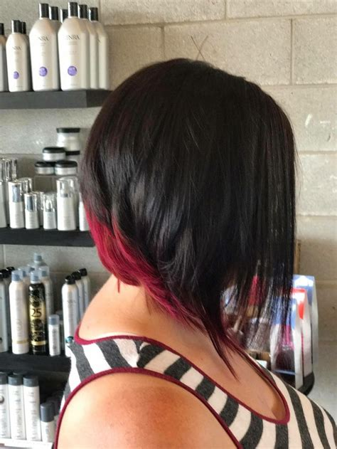 exaggerated bob haircut exaggerated bob with magenta red color underneath hair