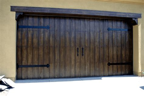 Wood Garage Doors Cost Faux Wood Garage Doors Cost New Style Steel Metal Doors With Ranch Look Fauxed They Are My