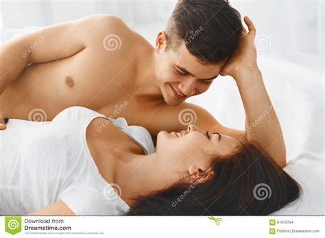 what men love in bed portrait of couple loving each other stock photo image