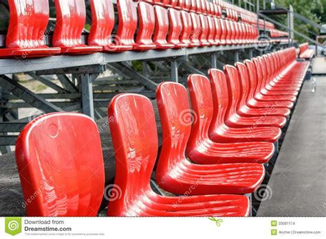 rows  red mini football stadium seats stock images