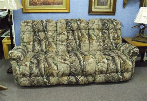 camouflage couch cover who wore it better hillary clinton or this sofa