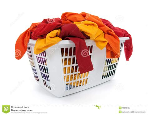 how to wash bright colored clothes clothes in laundry basket orange yellow stock