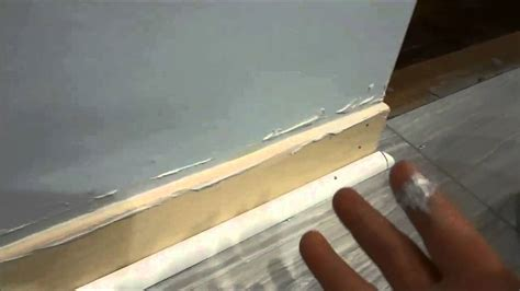how to fill gap between cabinet and floor bathroom tiles gap filler with beautiful image eyagci com