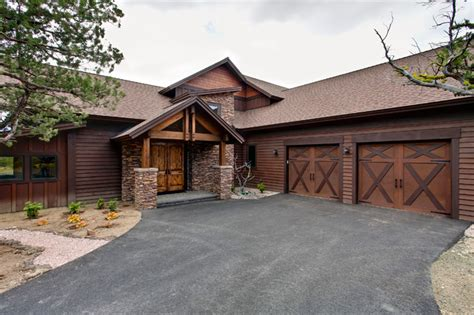Western Overhead Door Covered Entry And Carriage Style Garage Doors Rustic Exterior By Western Design International