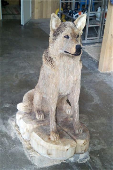 holzkuenstler schaeferhund malamut wolf kettensaegen fuchs