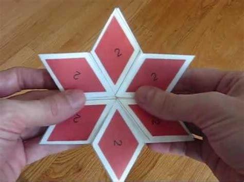 Origami Hexaflexagon - shows various flexes on a 6 sided rhombus hexaflexagon