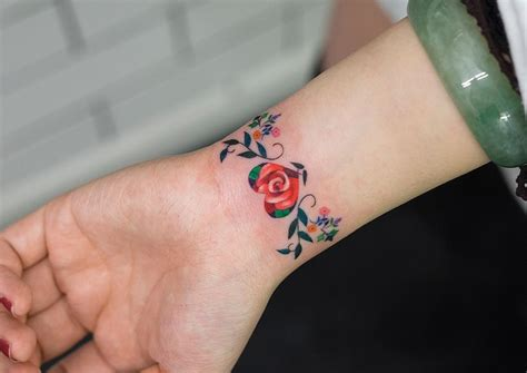 flower tattoo around wrist floral bracelet on s wrist best design