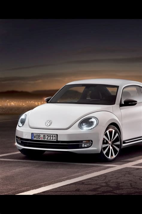 640x960 White 2012 Volkswagen Beetle Iphone 4 Wallpaper
