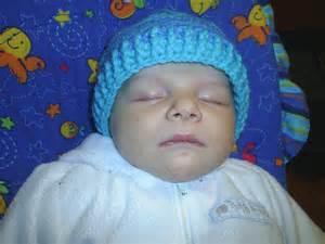 Baby gideon in his crochet baby hat