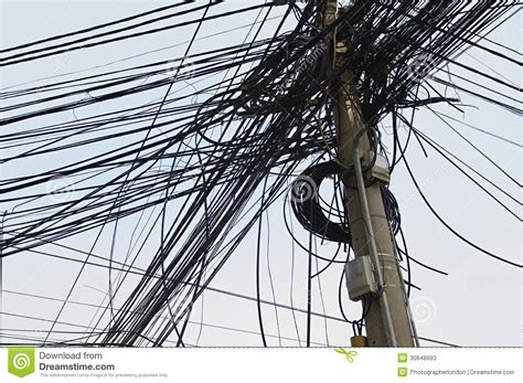 tangle of electrical wires on power pole stock image