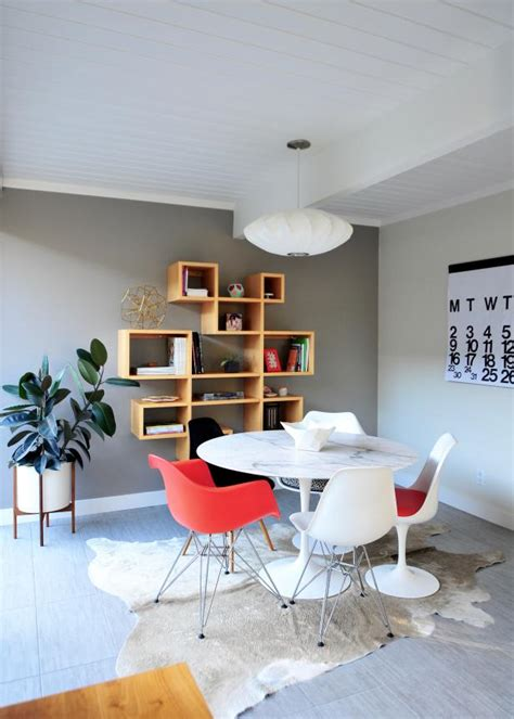 eclectic dining room  colorful chairs cowhide rug hgtv