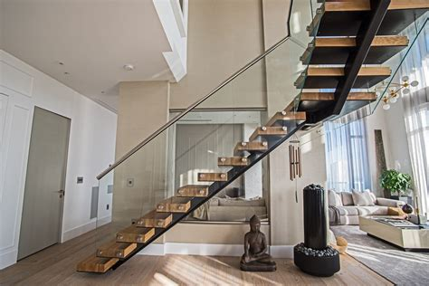 25 unique staircase designs to take center stage in your home staircase in the center of the house staircase gallery
