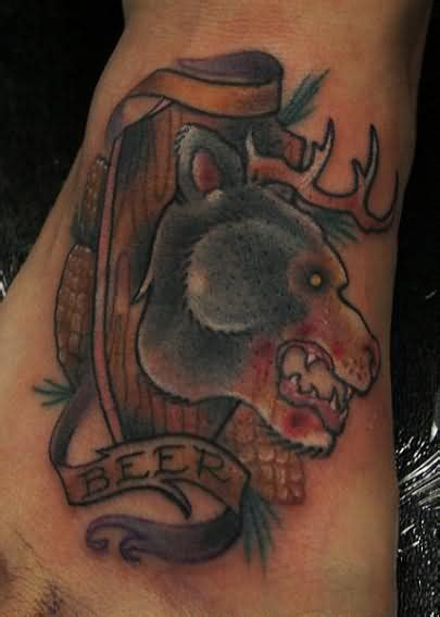 bear face tattoo on foot