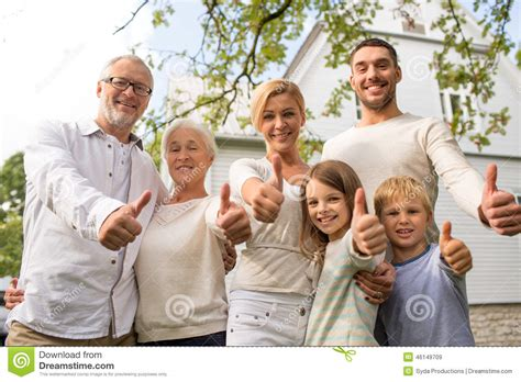 family and home happy family in front of house outdoors stock image