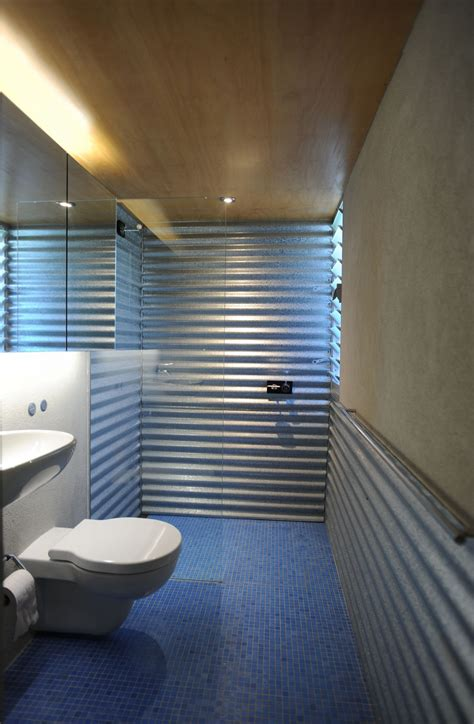 corrugated metal bathroom walls low cost renovation adds glamor to a 1920 s home