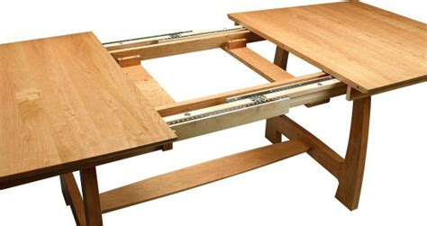 dining table with leaves stored inside watkins glen trestle table countryside amish furniture