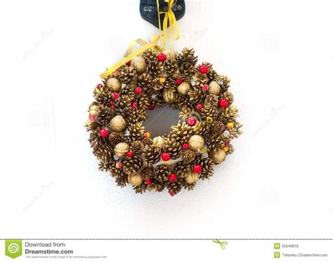 christmas tree branches in a circle with christmas toys