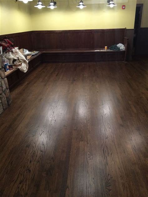 "2 1/4"" red oak hardwood flooring, stained with Minwax Dark"