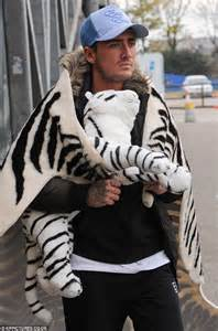 ikea tiger rug stephen bear wears an animal print rug as a cape during bizarre trip at ikea daily mail online