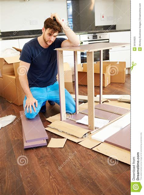self assembly furniture frustrated man putting together self assembly furniture