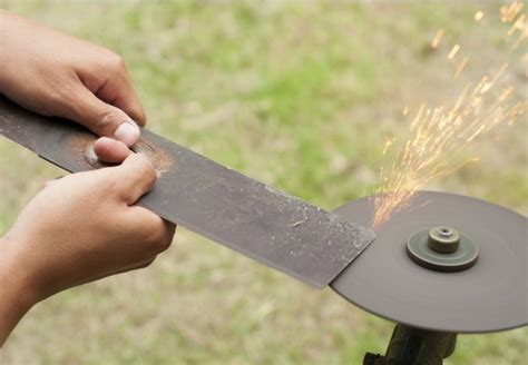 how to sharpen a lawnmower blade with a bench grinder how to sharpen lawn mower blades bob vila