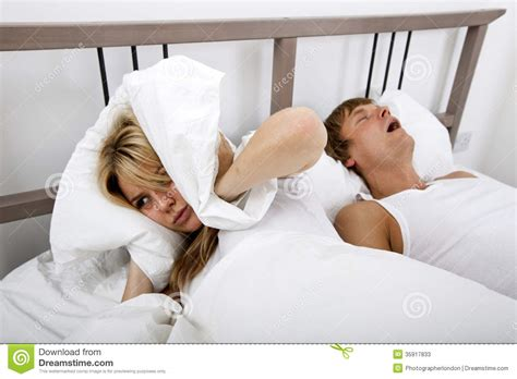 how to be good in bed for men frustrated woman covering ears with pillow while man