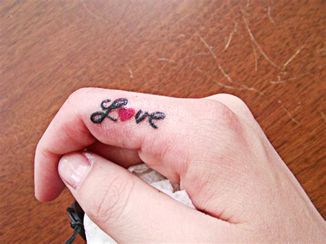 love tattoo on finger finger tattoos photo gallery