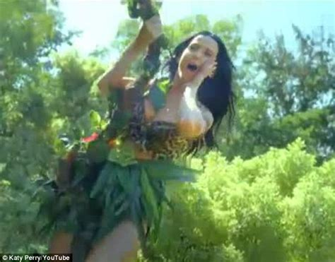 george of the jungle biggest swing katy perry wears leopard print bra as she swings from a