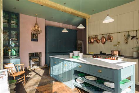 a pink green kitchen