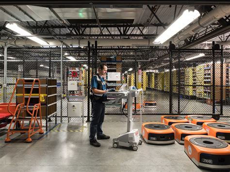 amazon warehouse robots amazon reveals the robots at the heart of its epic cyber