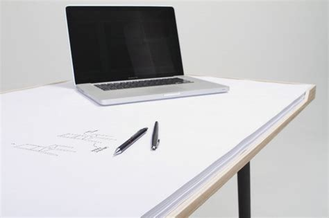 Desk Paper by Simple Desk With Big Pieces Of Paper On Top Desk