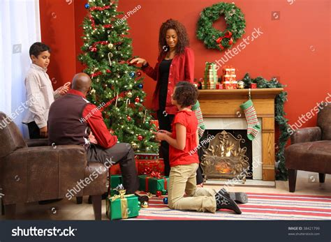 family decorating christmas tree stock photo 38421799