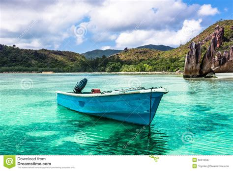 used boats van island old fishing boat on tropical beach at curieuse island