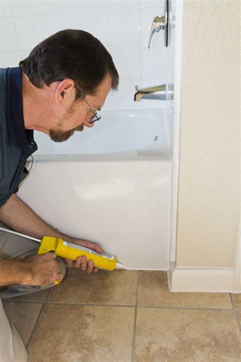 how to apply bathtub caulk 4 easy steps to removed that bathroom mildew buildup on