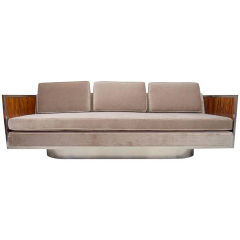 rosewood and chrome sofa with oval base attributed to