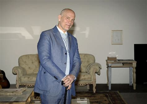john malkovich is the designer for what clothing label john malkovich presents his clothing and jewelry