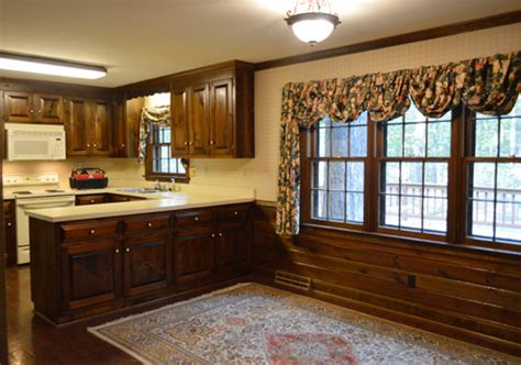 painting dark trim paneling   kitchen young house