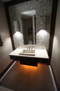 Contemporary powder room with mosaic tile backsplash corian counters